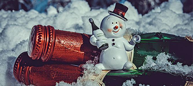 Snowman, wine and snow